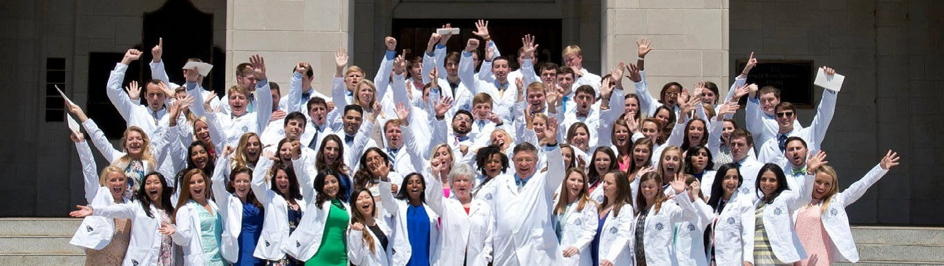 Students in their white coats